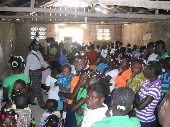 This room was packed with singing children welcoming us.